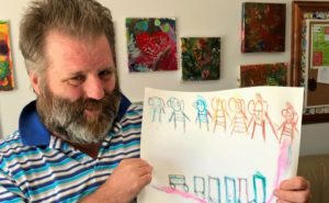Robbie OBrien at Creative Links with his art work