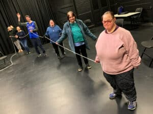 Our Drama Group back in action, physically distancing with the aid of a knotted rope.
